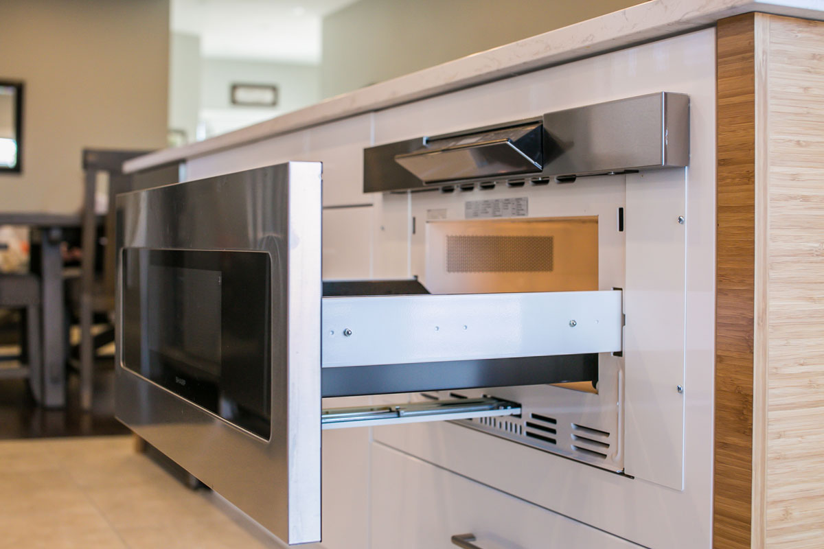 stainless steel microwave built into kitchen island
