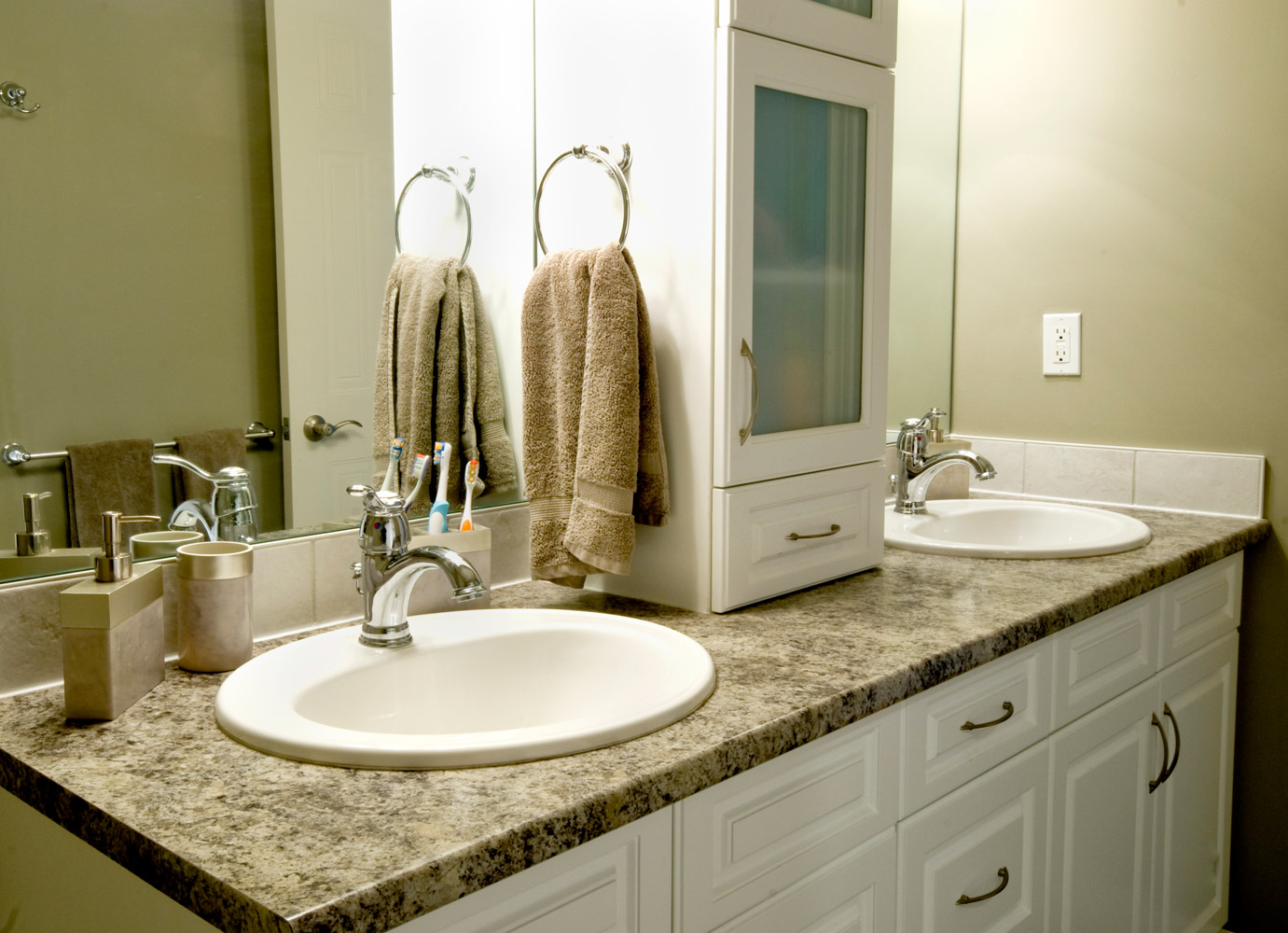 Cream and white bathroom design and renovation in barrie ontario with two sinks and lots of storage