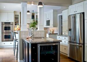 White kitchen design with hardwood floors and bar fridge - Total Living Concepts barrie ontario