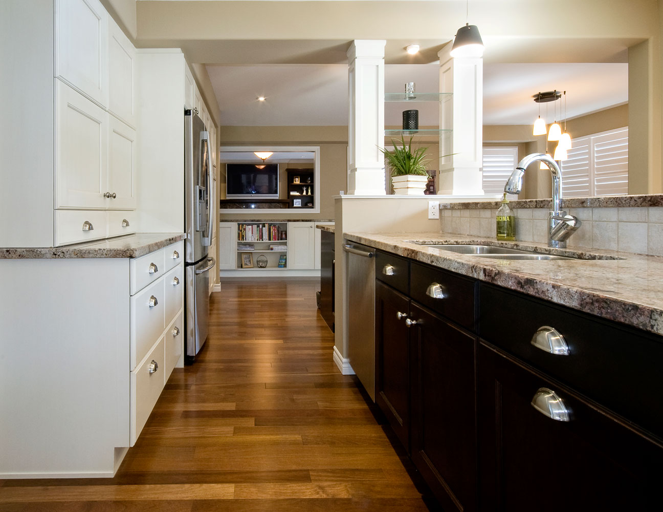 Kitchen design with white and dark wood cabinets and hardwood floors