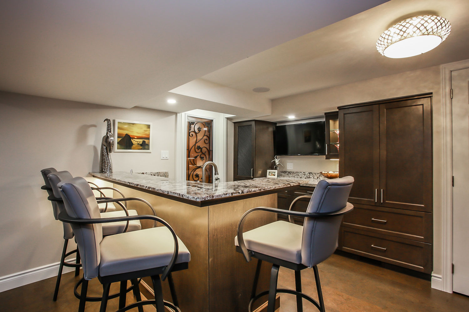 basement suite renovation with kitchen island