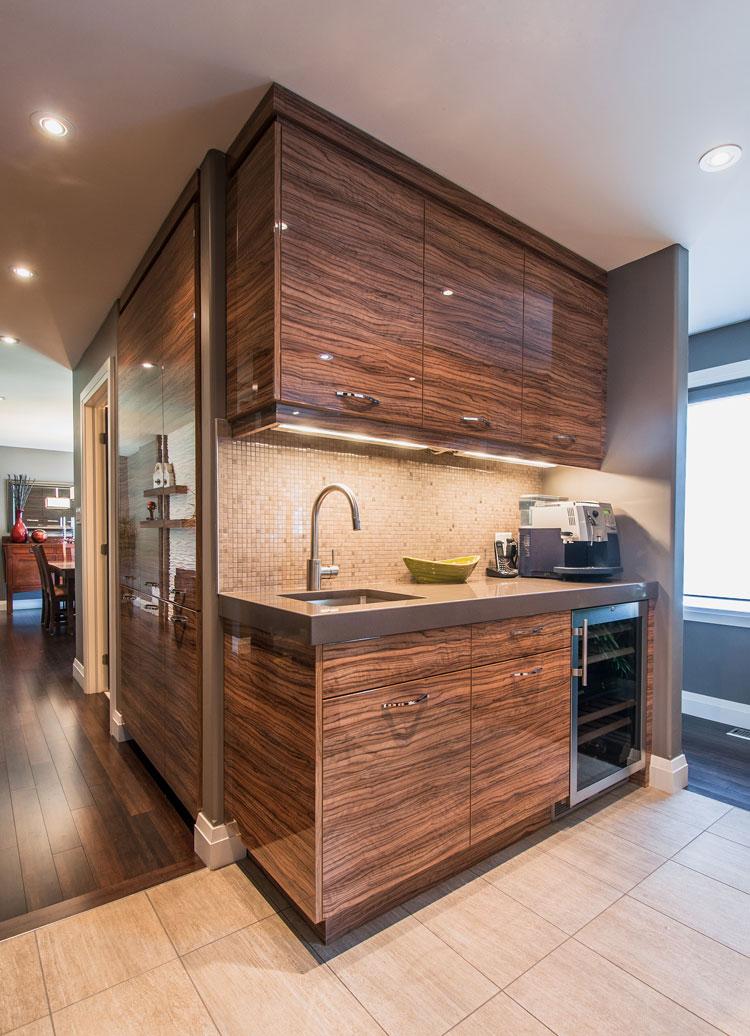 bar area in kitchen with wine fridge