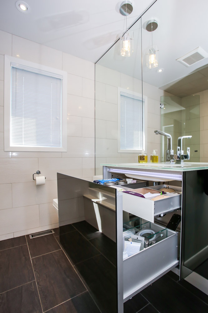 contemporary bathroom with hidden vanity drawers
