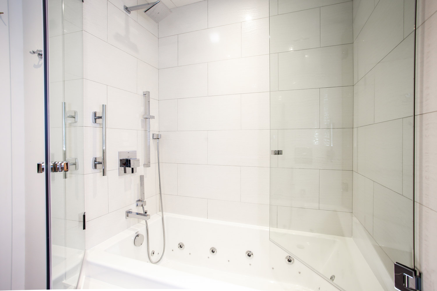 contemporary show with double glass doors and jetted tub