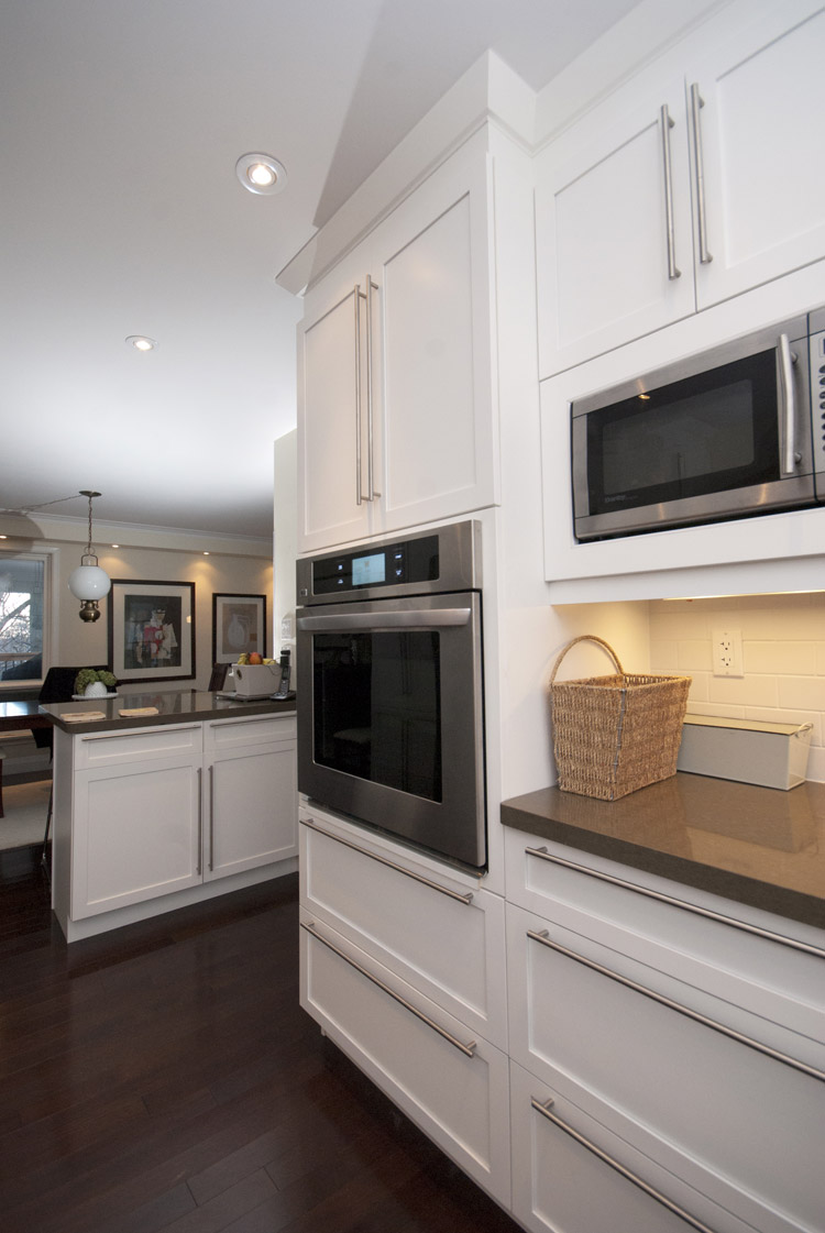 white kitchen with wall oven and microwave - Total Living Concepts