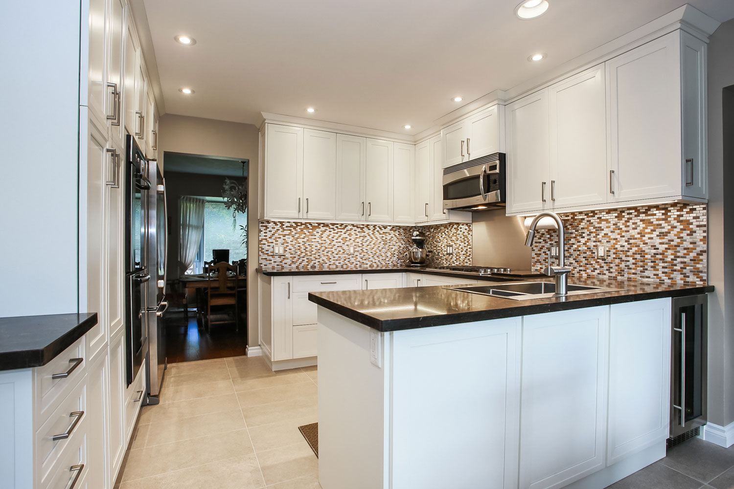 White Kitchen design with stainless steel appliances - Total Living Concepts barrie ontario