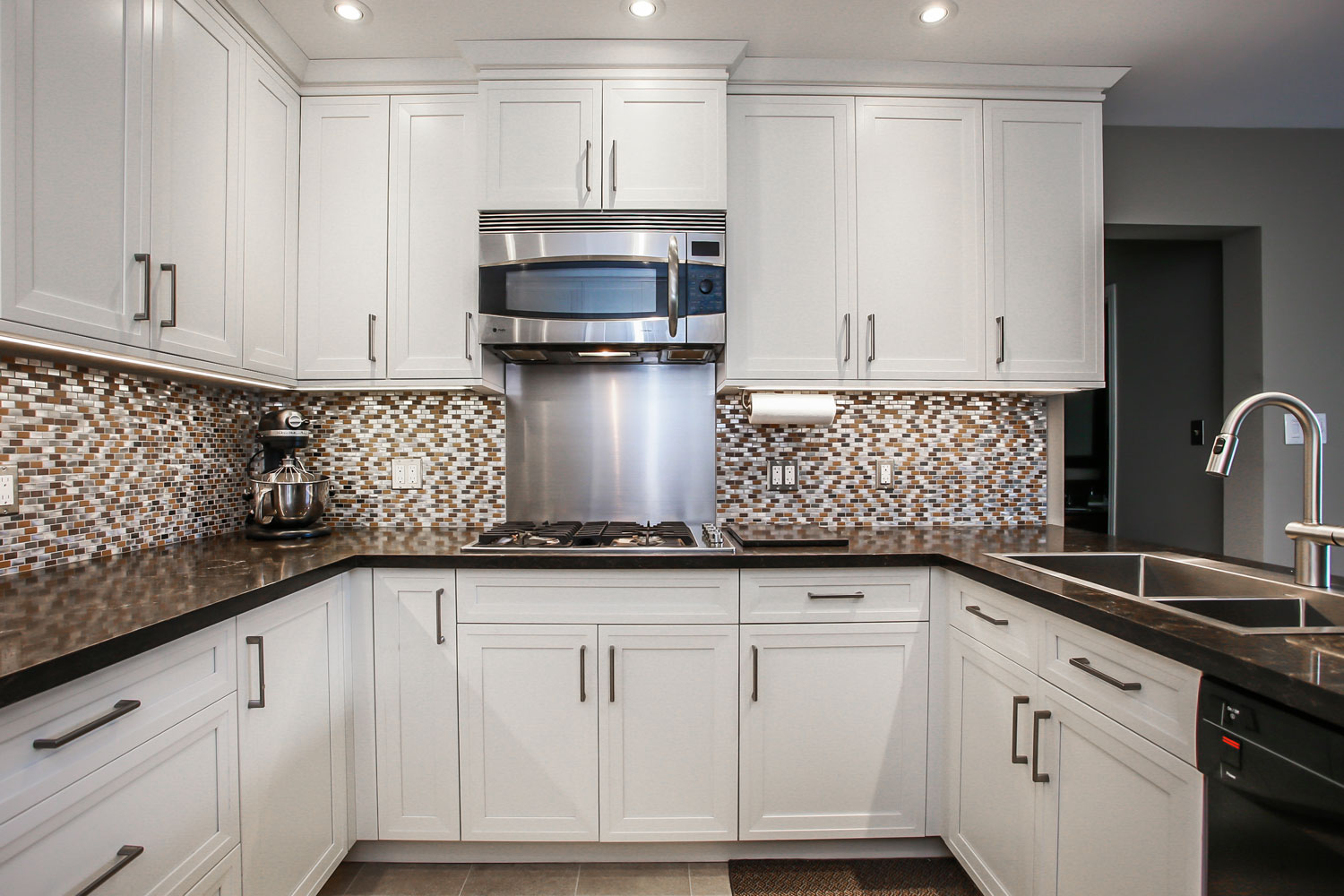 White kitchen design with built-in microwave