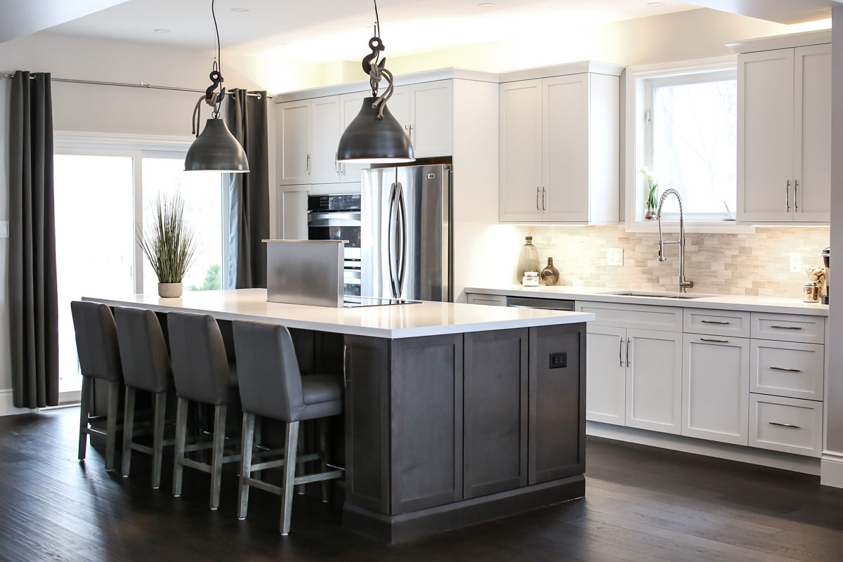 Kitchen design and renovation with two-tone white and dark cabinets, large island with eating bar - barrie ontario