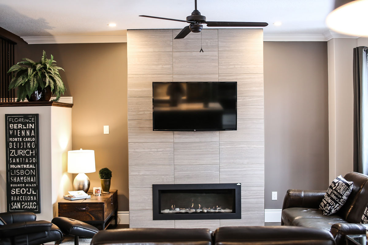 Open concept kitchen to living area with modern fireplace - living room renovation barrie ontario