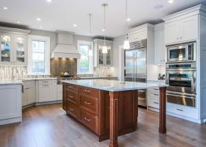 Large transitional kitchen design with white cabinets and cherry wood island - total living concepts barrie ontario