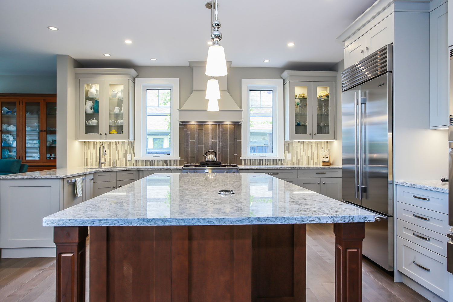 large kitchen island with granite coutertops