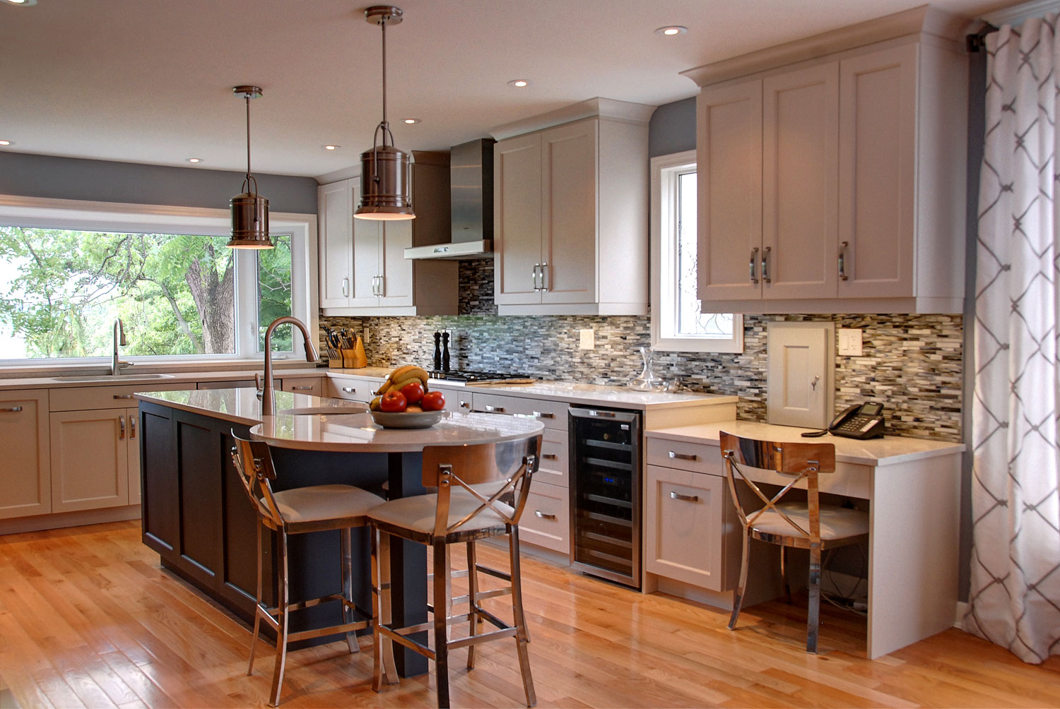 Lakefront cottage kitchen design and renovation with two tone cream and grey blue cabinets, a large island, stainless steel appliances, and hardwood floors - Total Living Concepts in Barrie Ontario