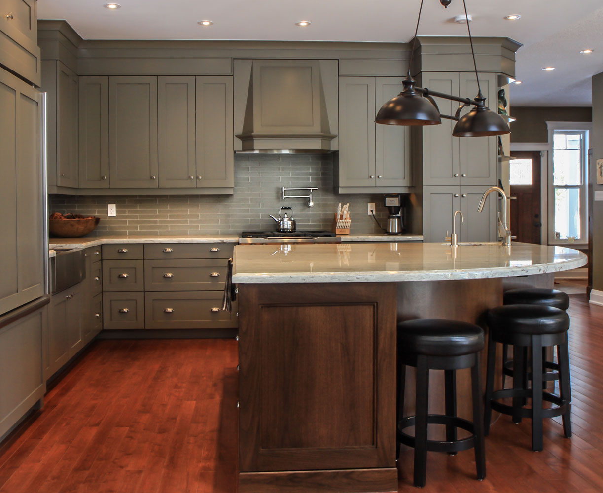 Warm kitchen design with grey cabinets and dark wood cabinets on the island and hardwood floors - Total Living Concepts barrie ontario