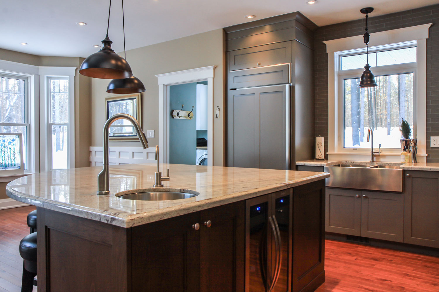kitchen design with hidden fridge and bar sink in the island - Total Living Concepts barrie ontario