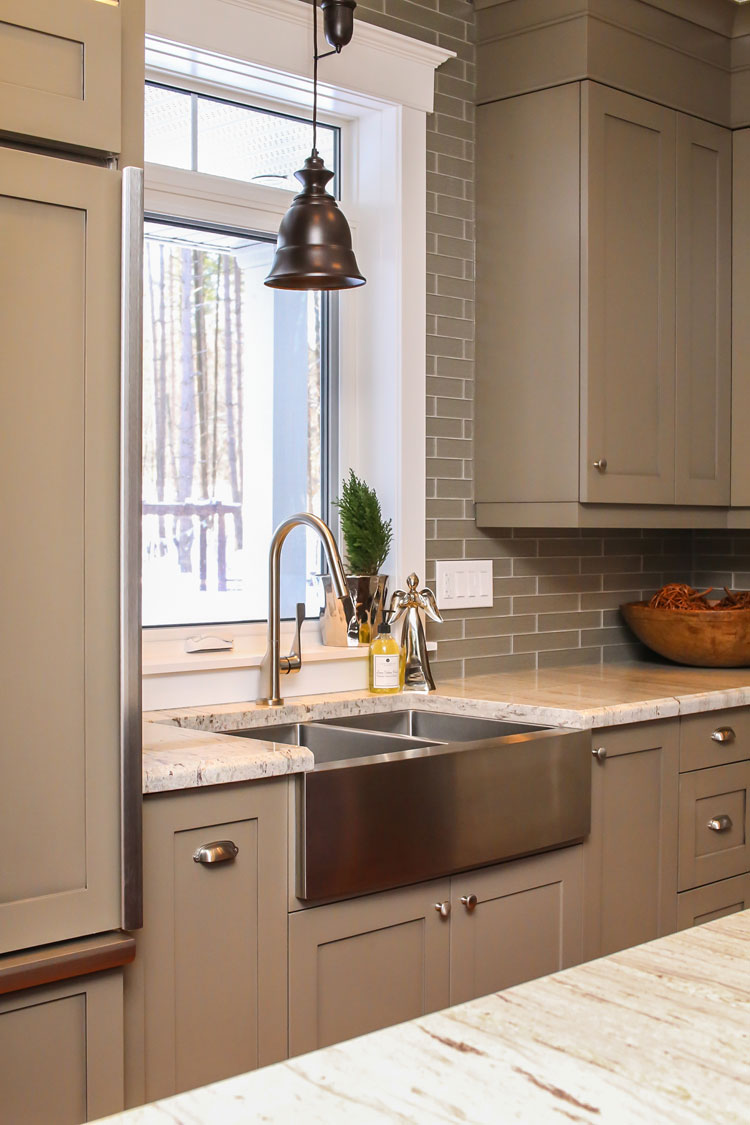 kitchen with stainless steel farmhouse sink - total living concepts