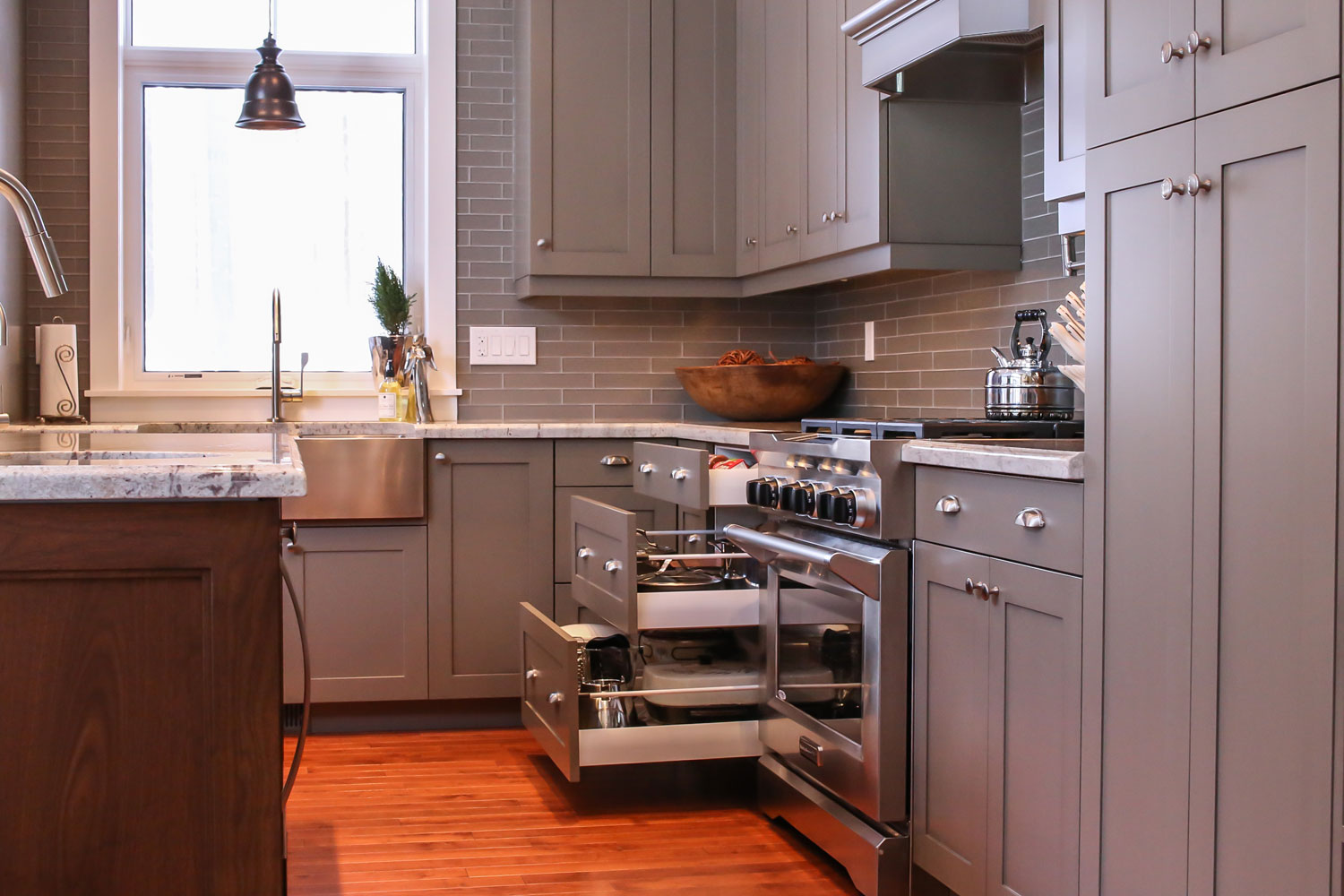 kitchen design with convenient pull out pots and pans drawers