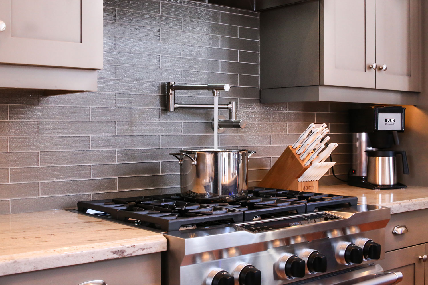 kitchen design with water faucet above the stove - total living concepts barrie ontario