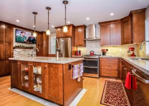 Modern counry kitchen design with cherry oak cabinets, stainless steel appliances, and a light hardwood floor - Total Living Concepts barrie ontario