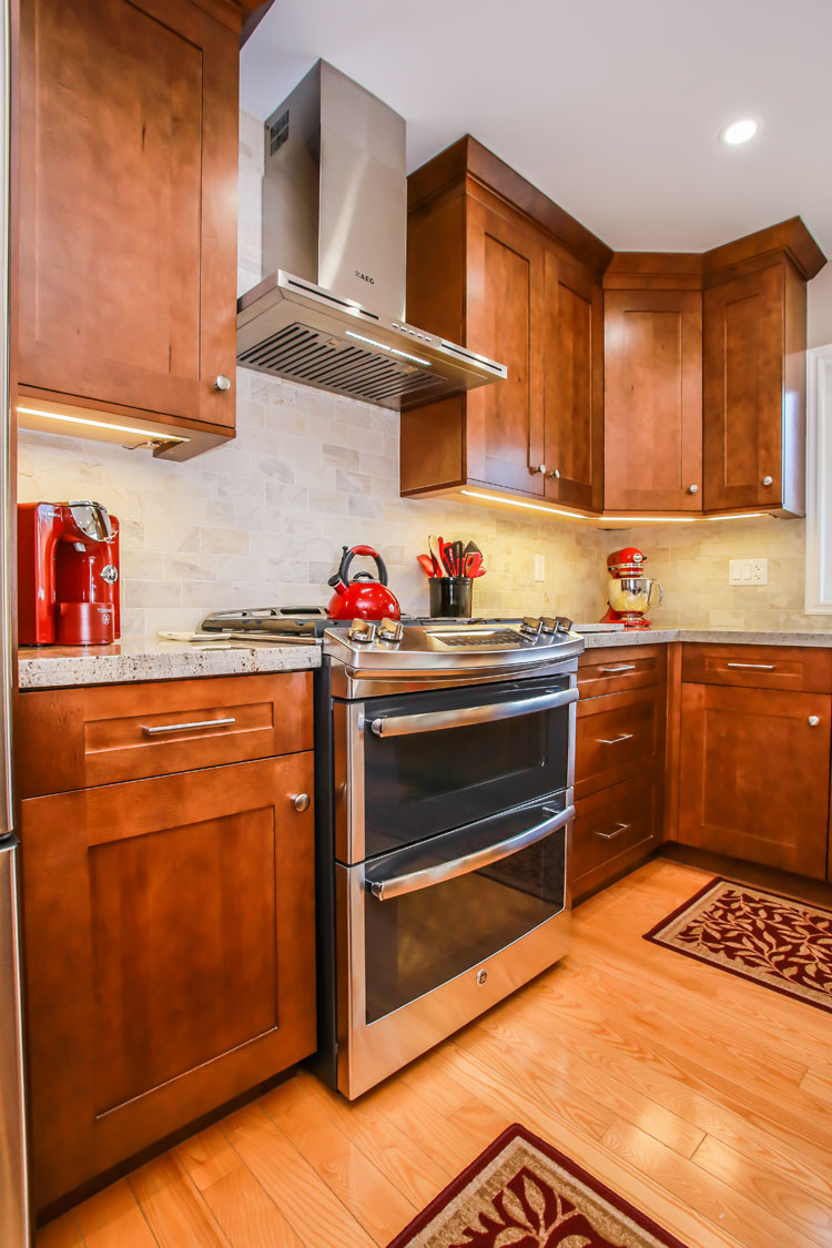 Modern country kitchen with stainless steel and red accents