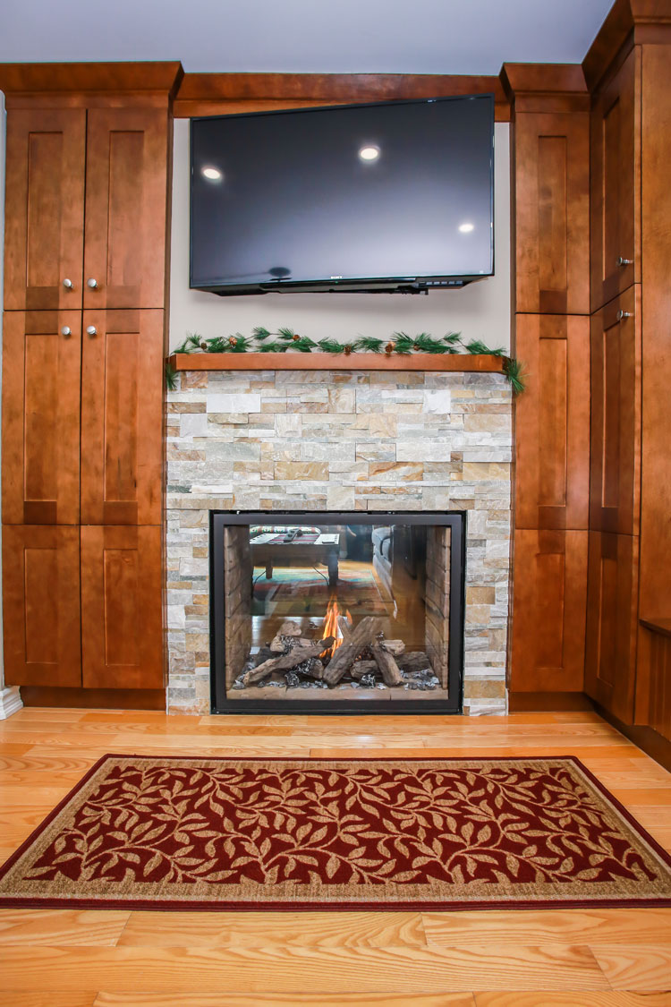Fireplace between kitchen and living area