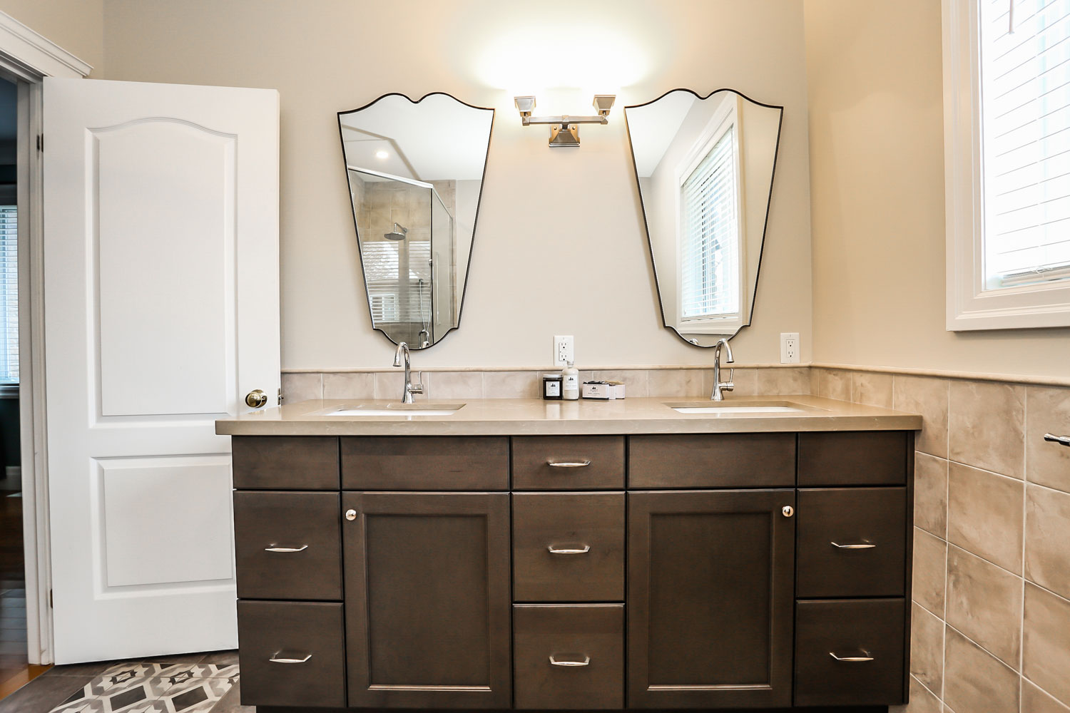 Ensuite with dual sinks and uniquely shaped mirrors