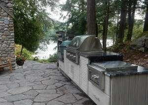 Outdoor Kitchen Design and Installation with NatureKast Outdoor Cabinets and Barbecue by Total Living Concepts