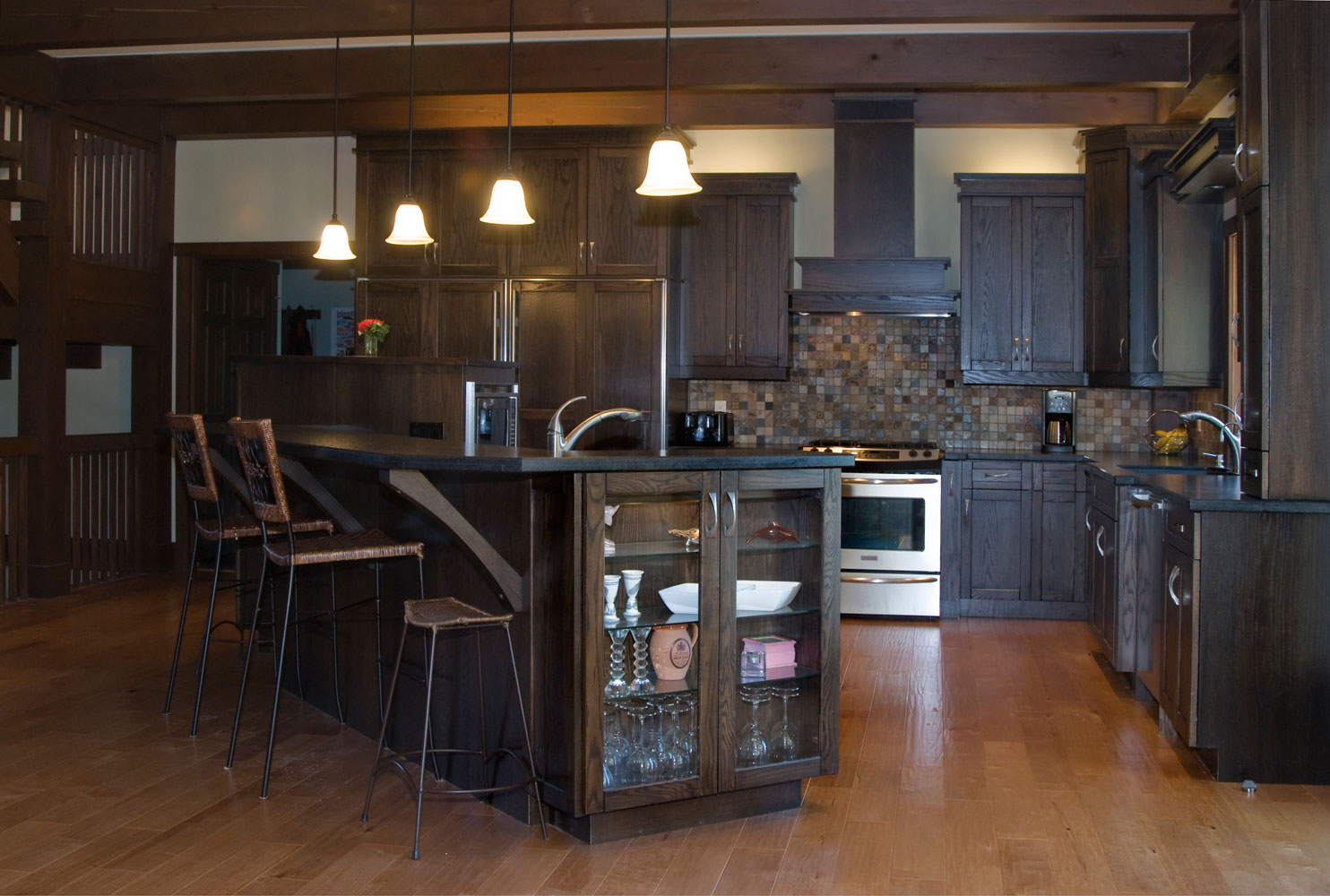 Large kitchen with dark wood cabinets and large island