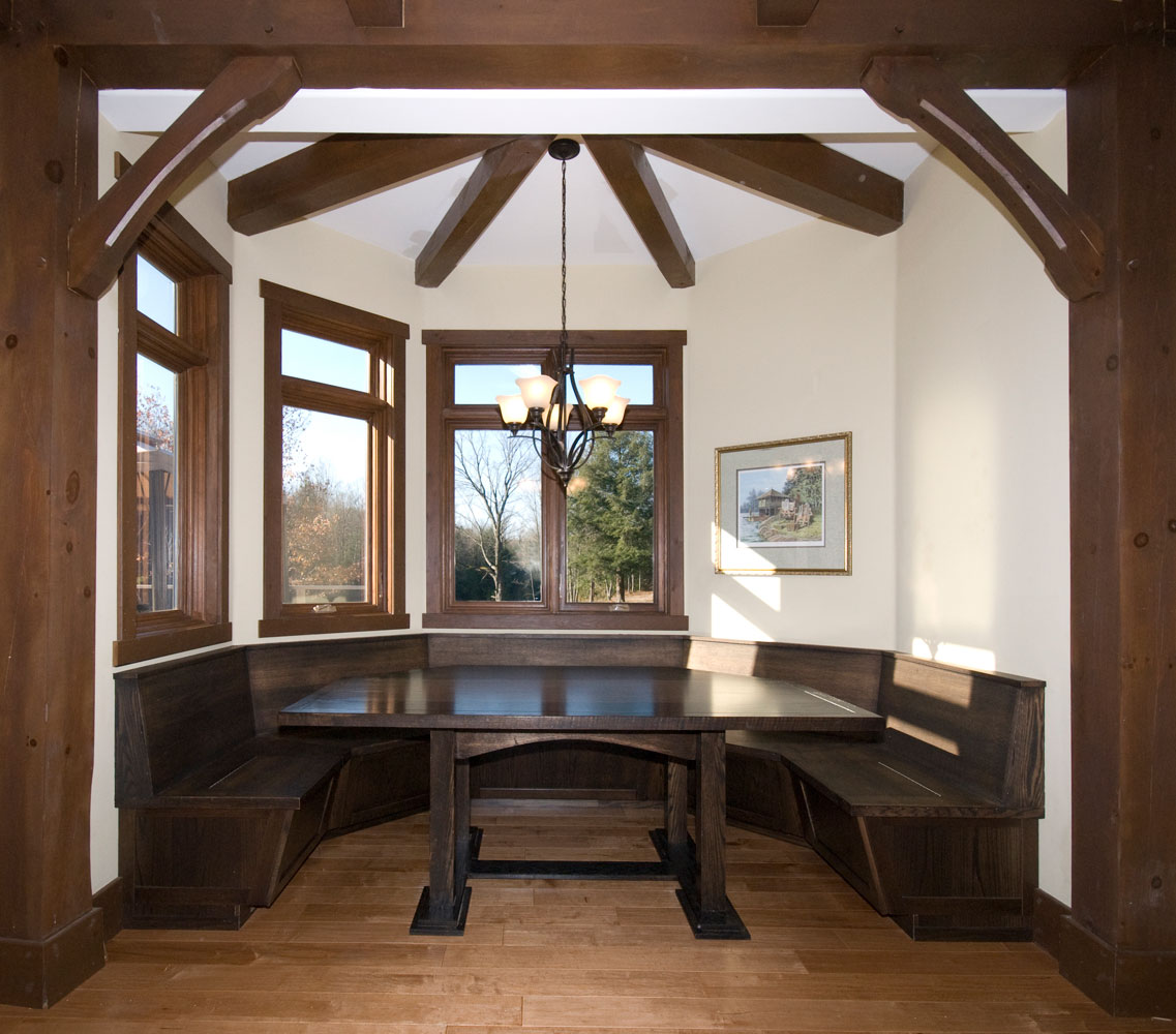 built in eating nook dining area with vaulted ceiling with wood beams