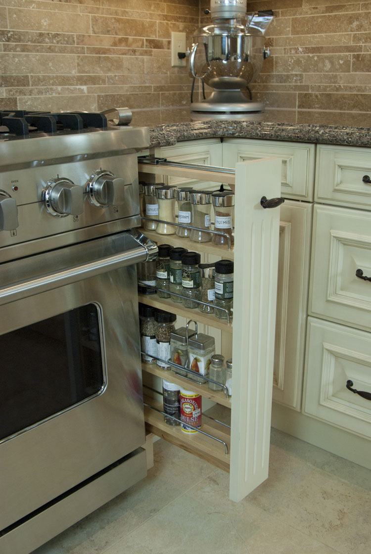 kitchen design with convenient pull-out spice drawer beside stove - total living concepts barrie ontario