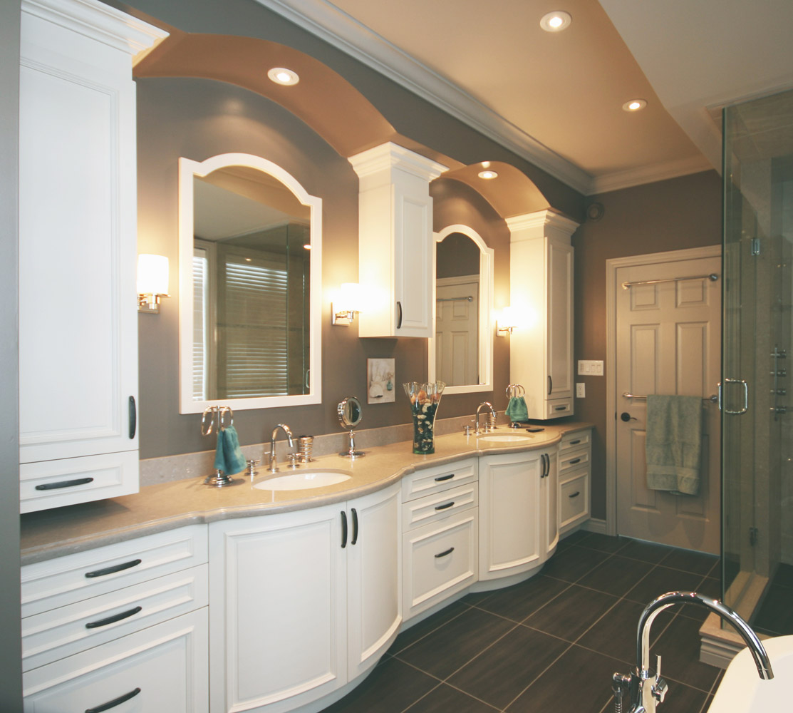 ensuite bathroom design with white cabinets and double sinks