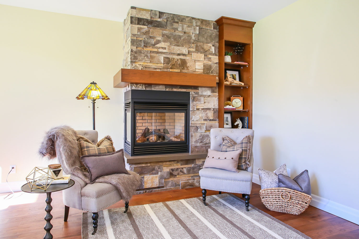 basement renovation with 2-sided fireplace and comfortable sitting area - total living concepts barrie ontario