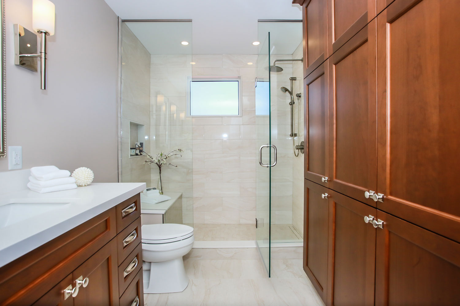 ensuite design and reno with cherry cabinets and standup shower