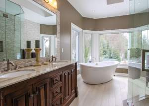 Traditional large ensuite design with dual vanities, floating soaker tub, glass shower - Total Living Concepts barrie ontario