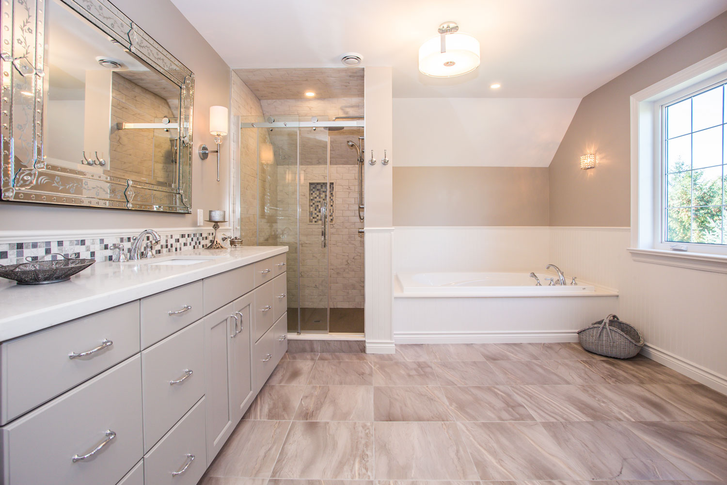 Large farmhouse style ensuite featuring warm greys and whites - Total Living Concepts barrie ontario