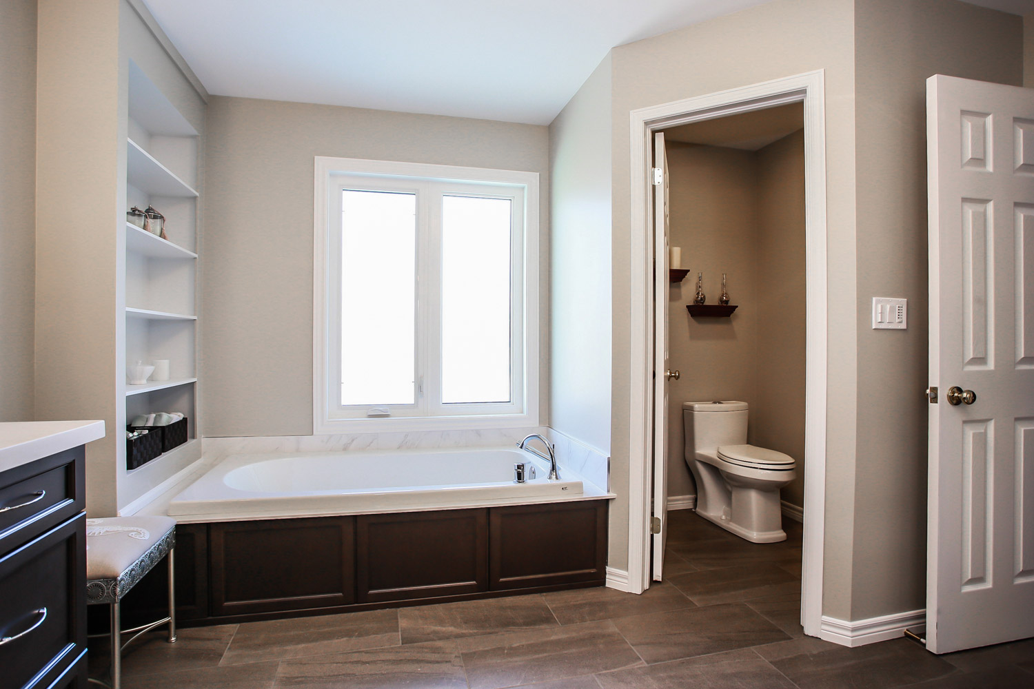 Ensuite renovation with dual vanities, stand up shower, soaker tub, and separate toilet room - Total Living Concepts barrie ontario