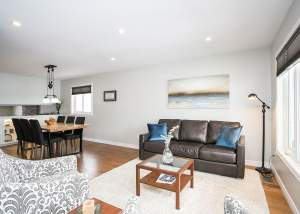 Design and renovation project in Barrie, Ontario featuring an open concept living and dining room area.
