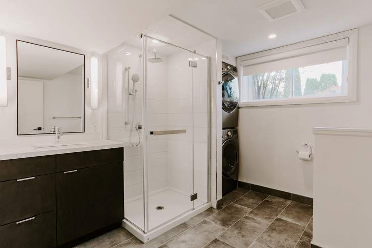 Bathroom design project with standup shower and stacked laundry area