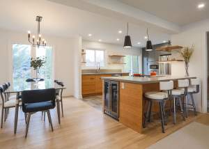 Modern transitional kitchen design and renovation in Barrie, Ontario featuring 2-tone cabinets, an abundance of storage, simple clean lines with open shelving, and an eat up bar with built-in wine fridge