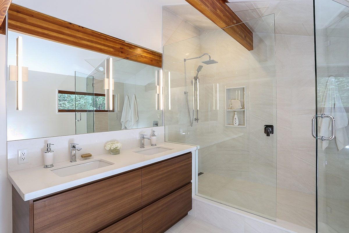 Clean white ensuite bathroom design with exposed wood beams and cabinets to match, oversized standup shower